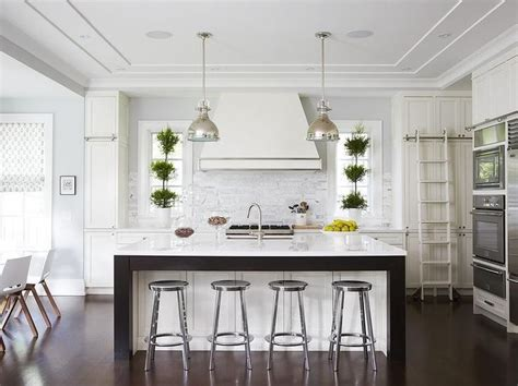 white  gray kitchen features white cabinets paired