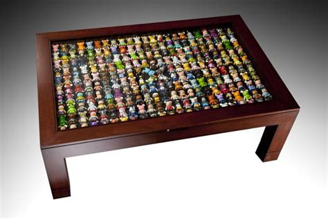 Yes, a coffee table exists for function more than anything. D23 Expo Auction: Vinylmation Table | Display coffee table, Disney home decor, Disney decor
