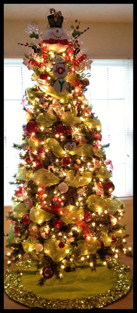 mesh ribbon and ornament decorated christmas tree