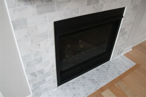 carrara marble fireplace constructionstyle