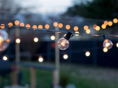 hang outdoor string lights  diy posts hgtv