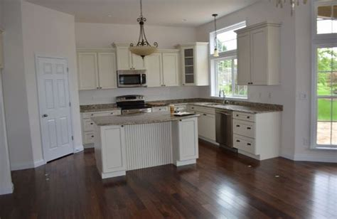 walnut floors  white cabinets home pinterest