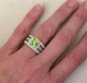peridot wedding rings cushion cut peridot and engagement ring and wedding band with milgrain edging and