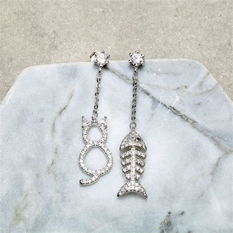 jassy 925 sterling silver cat with fishbone earrings