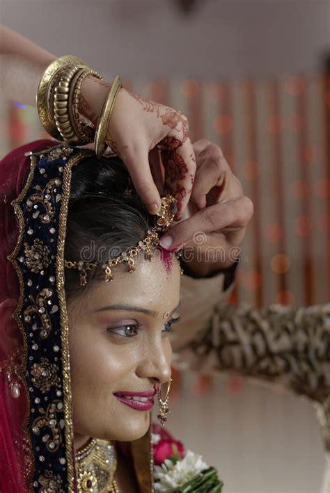groom putting sindoor  brides forehead  indian hindu