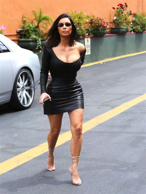 Kim Kardashian swaps up her style in sexy leather skirt ...