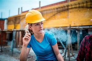 Manual Worker On Construction Site Stock Photo