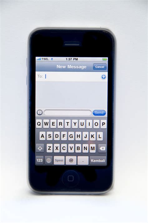 iphone keyboard file a white iphone 3g displaying keyboard in