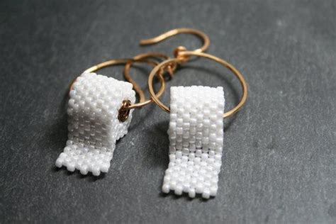 items similar  funny earrings hoops toilet paper seed