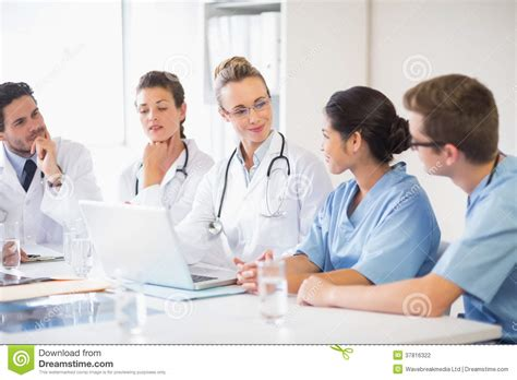 team  doctors  nurses discussing stock photography