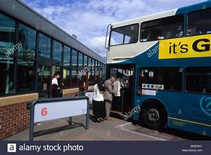 bus and passengers at Leeds city bus station Yorkshire UK ...