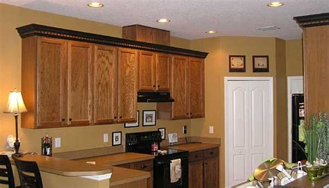 crown molding on kitchen cabinets pictures crown molding a different color than cabinets 9522