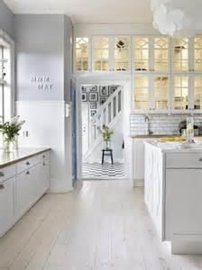 white kitchen white wash floor boards kitchen