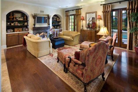 tuscan style family room  oversized furnishings hgtv