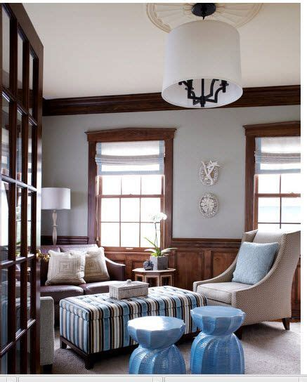 love the woodwork with the gray and roman shades