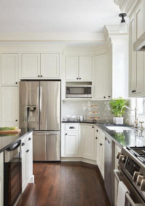 As well as their ability to complement traditional, transitional and contemporary designs. Off-white shaker island cabinets are adorned with oil ...