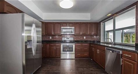 color of kitchen cabinets what color would you repaint these cabinets hardwood 5546