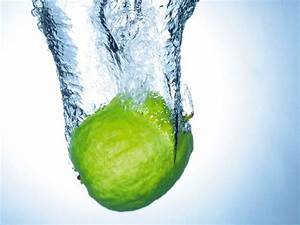 Nature Fruit Image, a Green Apple Jumping into the Water ...