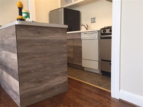 vinyl kitchen cabinets how to reface kitchen cabinets using vinyl flooring curbly