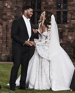 ciara and russell wilson pose in front of a castle for With ciara wedding dress