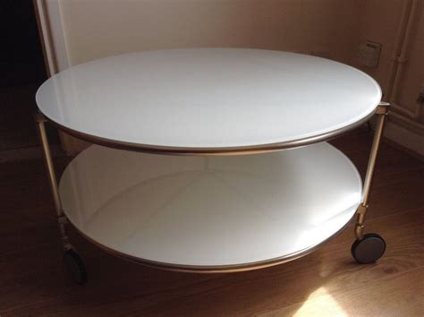 A glass coffee table makes for an elegant, subtle addition to the room, while a coffee table with storage is perfect for creating space for a striking centrepiece. STRIND IKEA round glass coffee/tea table. White. Must go 29th July   in Woking, Surrey   Gumtree