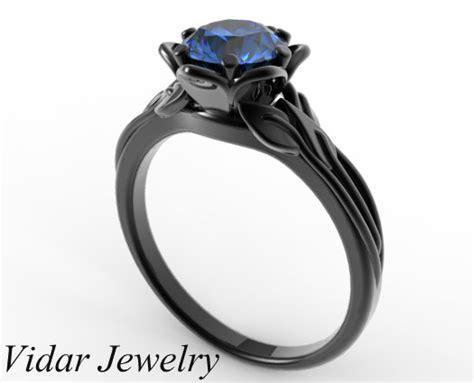 Custom Blue Sapphire Flower Engagement Ring In Black Gold