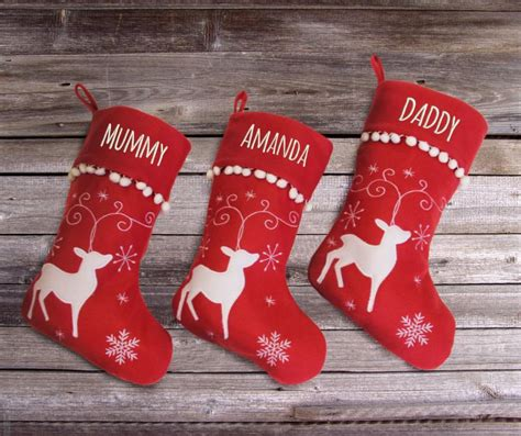 personalised christmas stocking  reindeer design withcongratulations