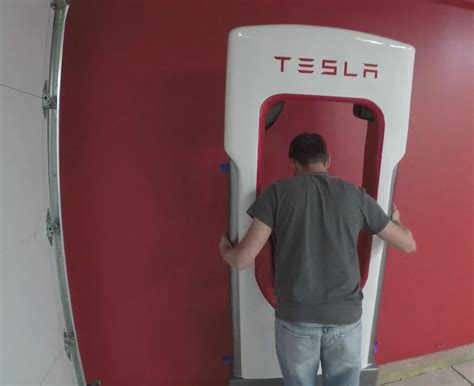 tesla owner builds  working life size supercharger