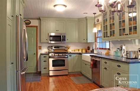 sage green country cottage kitchen with farmhouse sink
