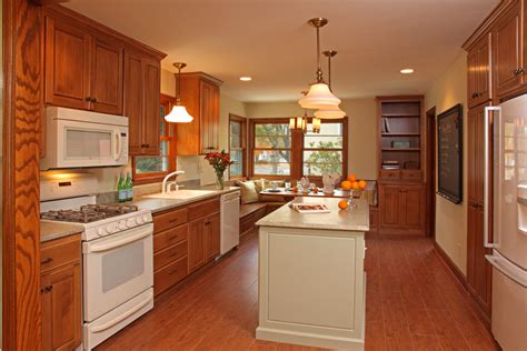 colors for a kitchen with light oak cabinets honey oak kitchen kitchen traditional with coast green 9940