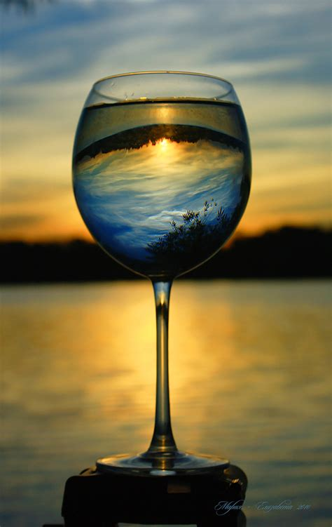 Inverted Reflections of Beautiful Landscapes on Glassware