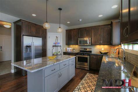 dark stained maple cabinets  custom kitchen  grey