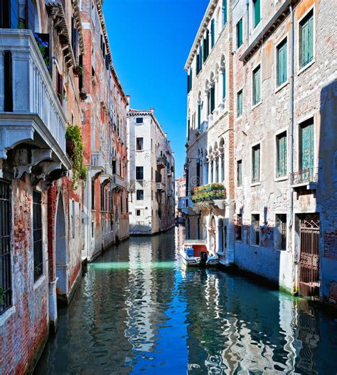 Colored Venice Canal With Houses In Water Stock Photo