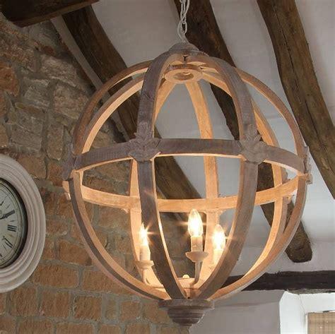 large  wooden orb chandelier wooden ceilings wood