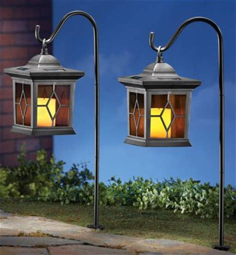garden candles shepherds hook and candle lanterns on