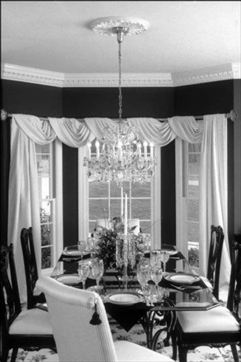 Dining room curtain idea. Black sheer fabric and burlap