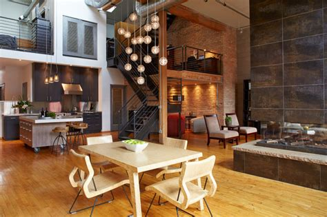 Chicago Fireplace by Downtown Industrial Loft Industrial Dining Room