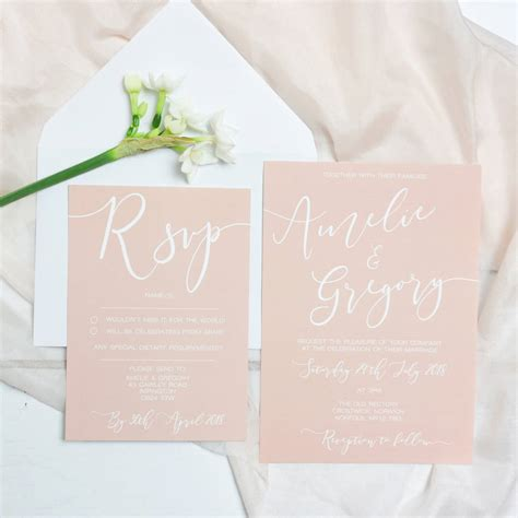 delicate blush wedding invitation and rsvp by eliza may
