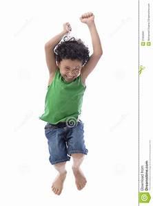 Happy Boy Jumping with Joy stock image. Image of child ...