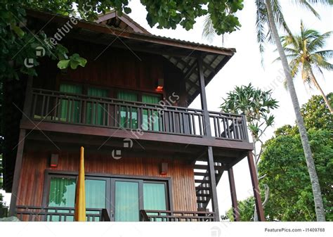 tropical beach house stock picture   featurepics