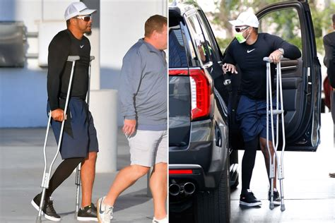 Tiger Woods returns to LA on crutches four months after ...