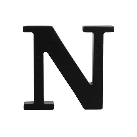 black stand wooden letter n black