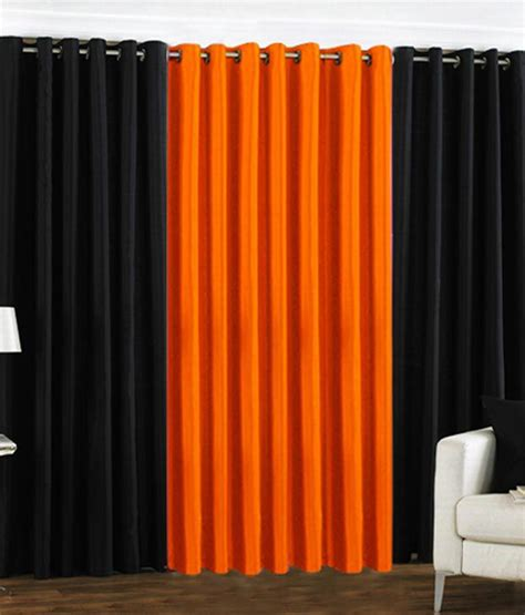 pindia plain eyelet curtains 7ft set of black orange