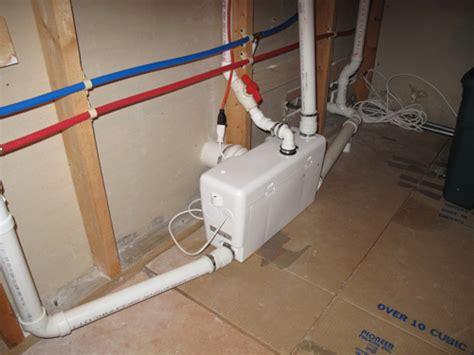 basement bathroom ejector floor saniflo product release herndon plumbing installer