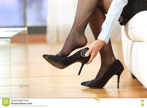 Businesswoman Taking Off Shoes Stock Photo  Image Of