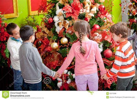 kids around christmas tree stock photo image of boys