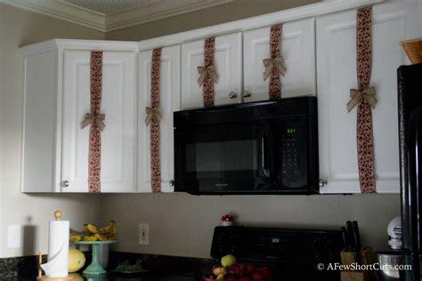 christmas cabinet ribbon decorations   shortcuts
