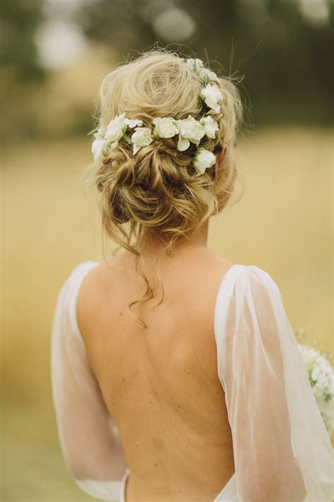 Flower Updo Hairstyles by Wedding Hairstyles 15 Fab Ways To Wear Flowers In Your