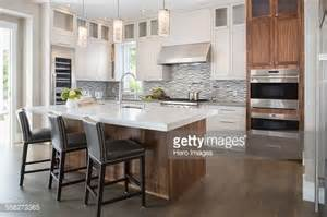modern pendant lighting for kitchen island pendant lights modern white kitchen island stock photo getty images