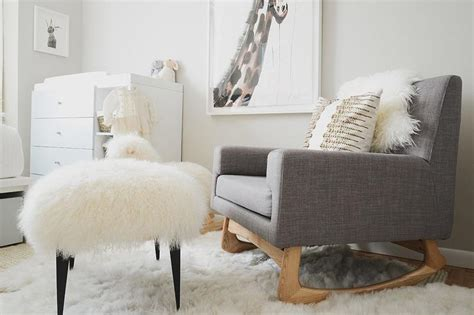 Nursery Sheepskin Rug by Two Tone Crib Next To Guest Bed Transitional Nursery